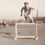 Alvin Christian Kraenzlein running the hurdles, c. 1900