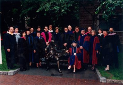 "Interim President Fagin, Interim Provost Lazerson, the deans of the University's twelve schools, and senior administrators pose with ""Ben on the Bench,"" Commencement 1994"