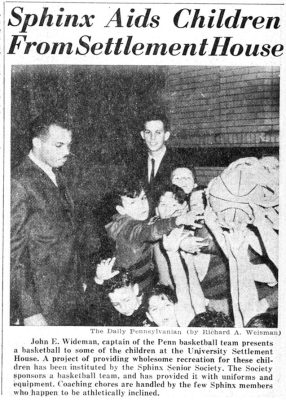 John Wideman, as part of the Sphinx Society, presents a basketball to some of the children at the University Settlement House, 1963