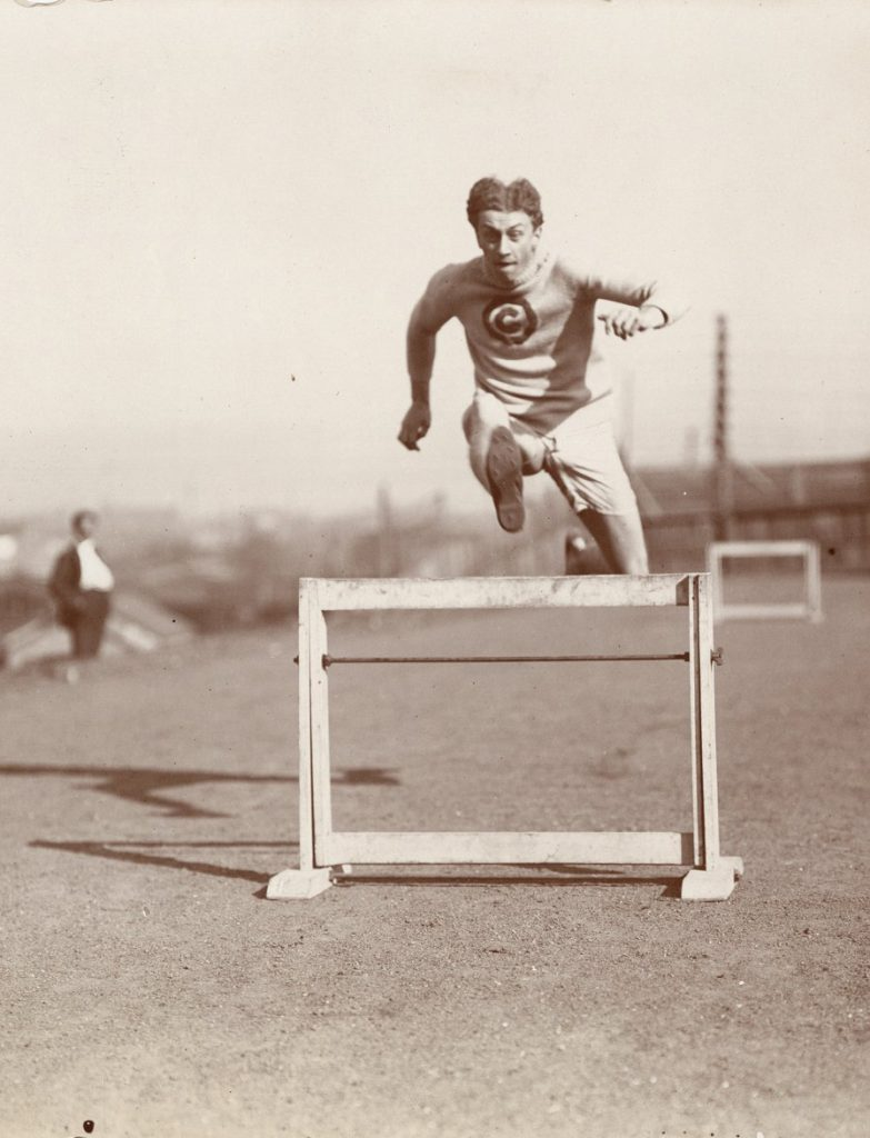 Alvin Christian Kraenzlein running the hurdles, c. 1900