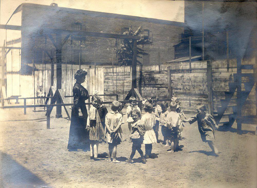 Settlement House, children on playground, c. 1908