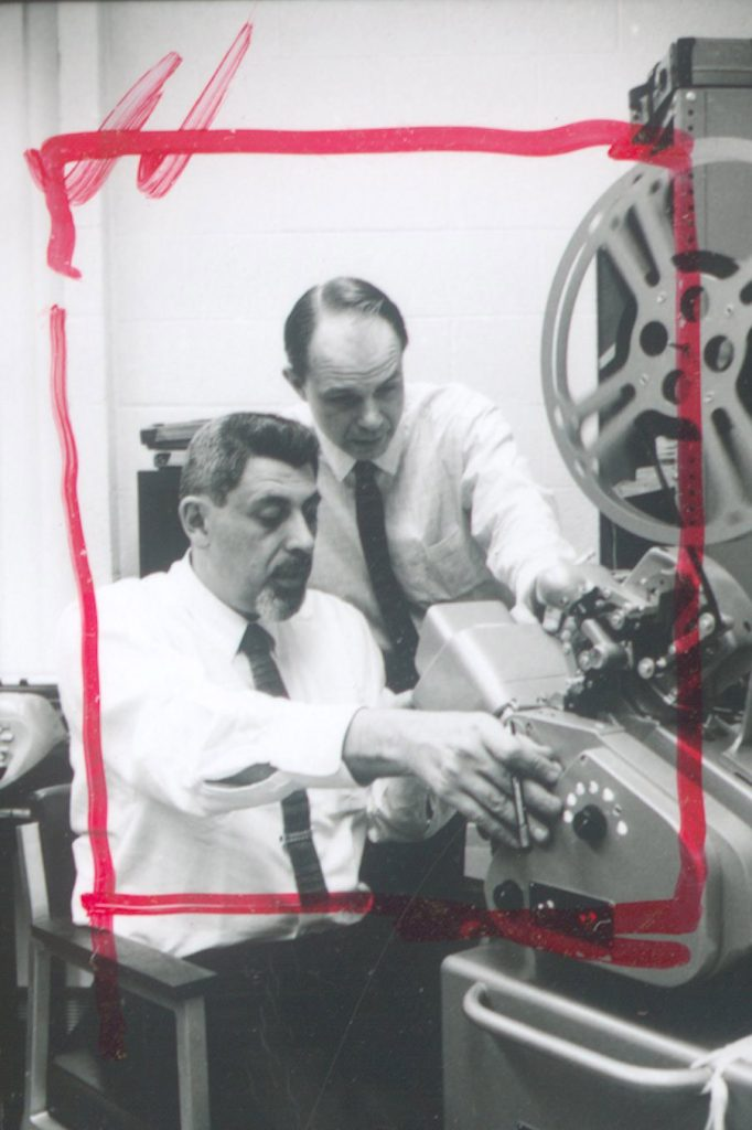 Sol Worth, working at a film projector, 1966