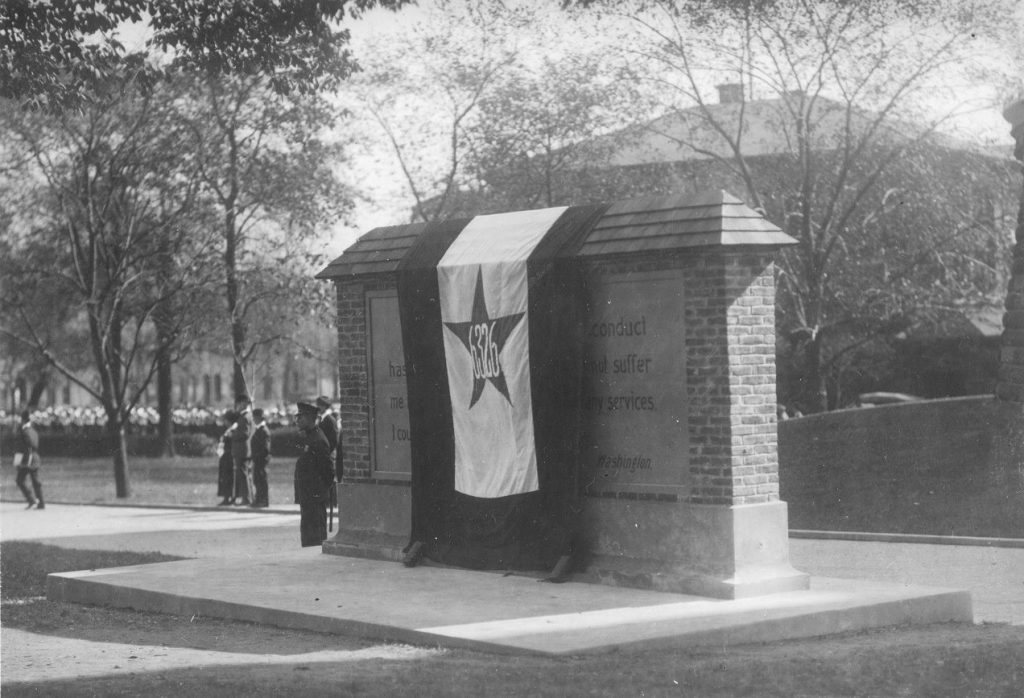 World War I, 6326 banner draped over a memorial, c. 1918