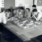 Architecture students discussing a model for women's campus, 1952