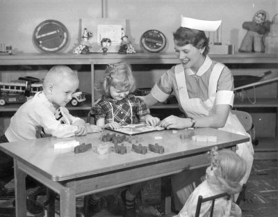 Student nurse, working with children in a play area, c. 1960-1970