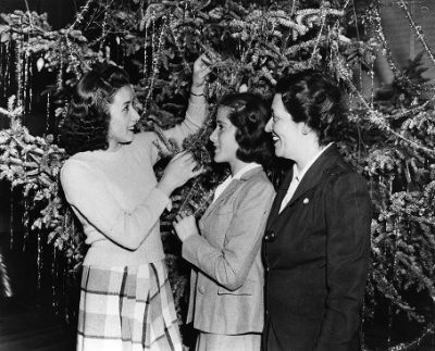 Colombian student visit Penn for six weeks during the winter 1941-1942: three of the 32 students in front of a Christmas tree, 1941