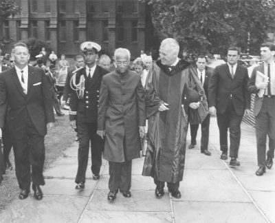 Indian President Sarvepalli Radhakrishnan and Penn President Gaylord P. Harnwell walking across the Penn campus with security detail and others, 1963