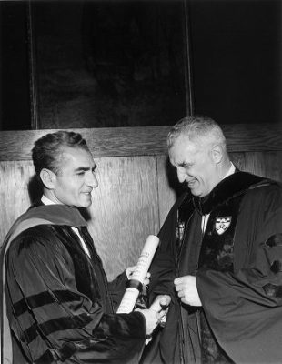 Shah of Iran, Mohammad Reza Pahlavi (1919-1980), LL.D. (hon.) 1962, holding his honorary degree, shakes hands with Penn President Gaylord Harnwell, 1962
