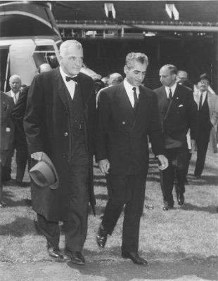 Shah of Iran, Mohammad Reza Pahlavi (1919-1980), LL.D. (hon.) 1962, walking from helicopter with Penn President Gaylord Harnwell, 1962