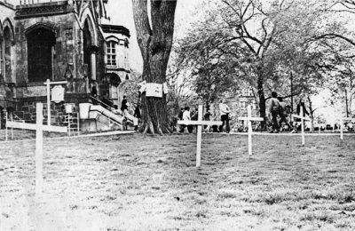 Vietnam War protest of crosses in front of College Hall, 1970
