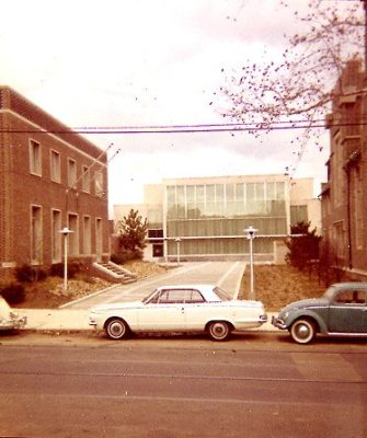 West side of 200 block of South McAlpin Street, 1961, showing the 3600 block of Locust Street in the foreground, the new Delta Phi fraternity house at 3627 Locust Street at the left margin, and the Annenberg School under construction in the background. Delta Phi (St. Elmo), established in 1849, is the University's oldest fraternity. It had owned a house at 3453 Woodland Avenue, but the University acquired that property for the construction of the new Van Pelt Library and offered the site at 3625-29 Locust Street as suitable for relocation.