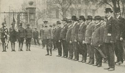 A portion of the Faculty Squad waiting for the Patriotic Day parade to start, 1917