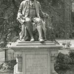 Statue of Benjamin Franklin by John J. Boyle in front of College Hall