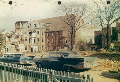 East side of 200 block of South McAlpin Street, 1960, with demolition-in-progress continuing on the south side of 3600 Walnut Street. This view, however, is toward northeast and in the background is the new, four-story Faculty Club at the southwest corner of 36th and Walnut Streets. Planning for a modern and greatly enlarged Faculty Club was initiated in November 1954, but construction did not begin until late February 1958. The cornerstone was laid at ceremonies held on 26 May 1958 and a reception to mark the building's opening was held exactly one year later, 26 May 1959.