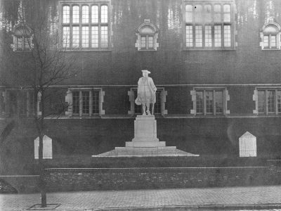 Statue of Young Benjamin Franklin, projection of statue and base on photograph of front of Weightman Hall, 1913