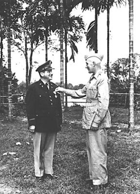 Ravdin receiving the Legion of Merit from Brigadier General Lewis A. Pick