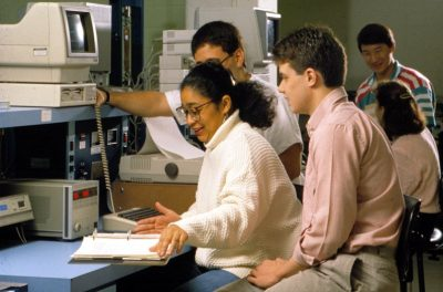 Research lab, students and electronic equipment, 1989